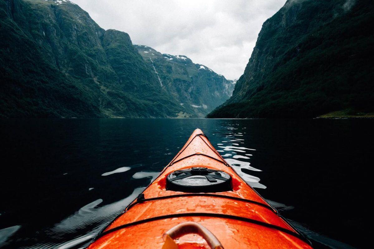 orange canoe on lake