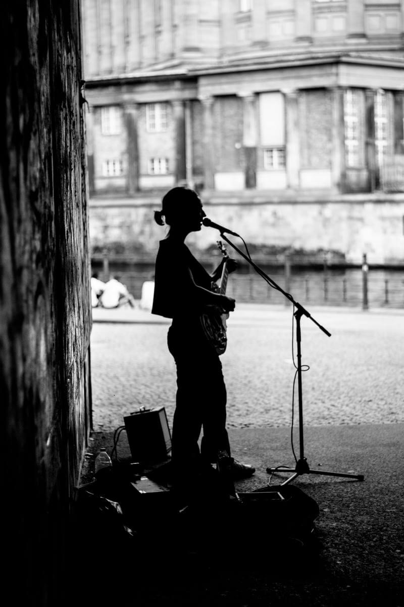 man singing using microphone