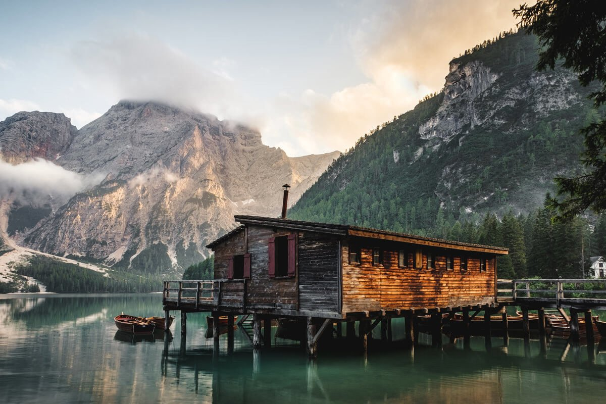 brown wooden house on the lake