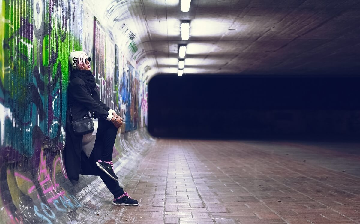 Portrait fashionable girl blonde fall urban trend style on graff